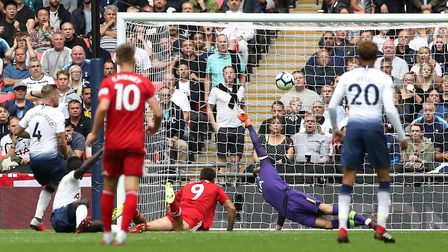 Fulham's Aleksandar Mitrovic (centre) scores his side's first goal of the game during the Premier Le