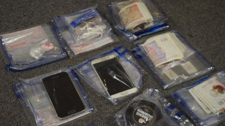 Phones, cash and drugs seized.