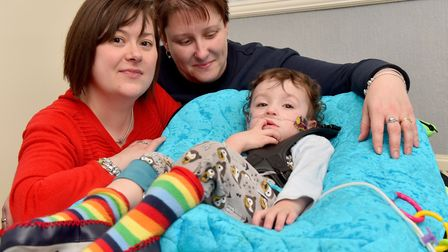Cohen Messenger at home with his parents Aimee and Kirstie.Picture: Nick Butcher