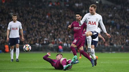 Tottenham Hotspur's Christian Eriksen scores against Manchester City at Wembley Stadium on April 14
