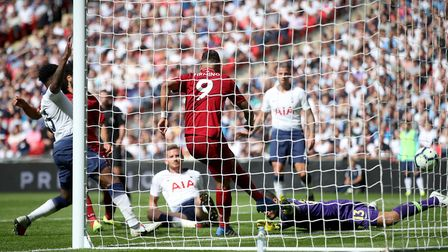Liverpool's Roberto Firmino (centre) scores during the Premier League match with Tottenham Hotspur (