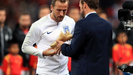 England manager Gareth Southgate (right) presents Harry Kane with the golden boot award for the 2018