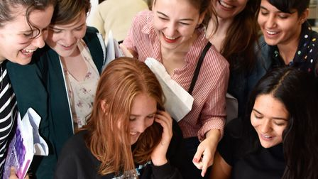 Parliament Hill School students celebrate their GCSE results in the new LaSWAP building. Photo by Ju