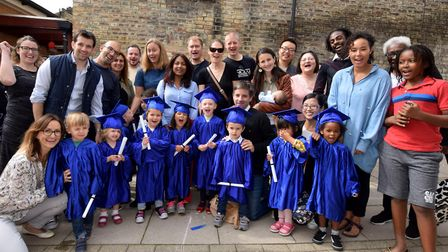 Staff and parents help leaving students at Chaston Nursery celebrate their graduation. Picture: Poll