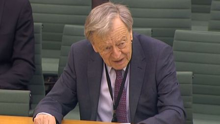 Labour peer Lord Dubs answering questions in front of the International Development Select Committee