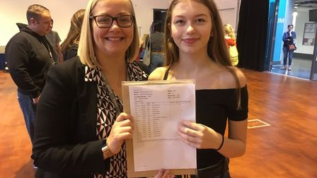 Head of school at Heartlands High School Elen Roberts with Zuzanna Kowalczyk and her GCSE results. P