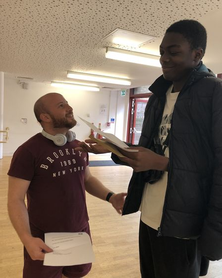 Emmanuel Oladeru with Mr Brett finding out his results at Hackney New School. Picture: Emma Bartholo