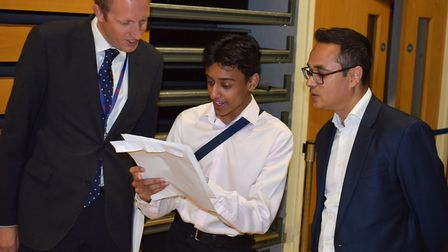 Haverstock School's headteacher James Hadley (left) and Councillor Abdul Hai (right) with one of the