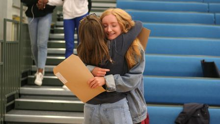 Katie McCaughey celebrates with a friend. Picture: Our Lady's Convent High School