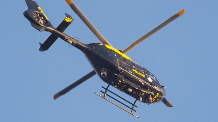 A police helicopter flies over London. Picture: DOMINIC LIPINSKI/PA IMAGES