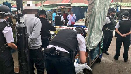 Officers raiding a stall in Ridley Road Market. Picture: Dalston Police
