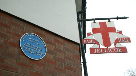A blue plaque in memory of Father Basil Jellicoe, a housing reformer who created housing for the com