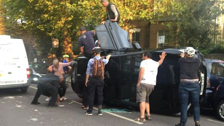 Passers-by helped the trapped passengers get out of the car in Downes Park Road
