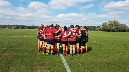 The Hampstead women's team huddle together (pic: Hampstead RFC)