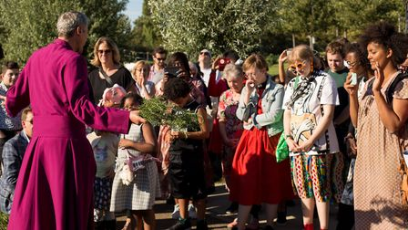 Churchgoers gather at the Lea Navigation canal to launch new church on a barge. Picture: Kristyan Ra
