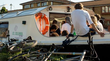 Congregation packs Sunday service aboard floating chuch at Hackney Wick. Picture: Kristyan Rachael