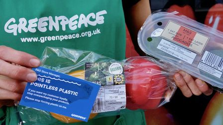 Greenpeace encouraged shoppers to hand back plastic packaging at the tills of Camden High Street's M