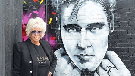Lisa Voice with Billy Fury's mural in West Hampstead. Picture: Dominic Nicholls / Decca Records