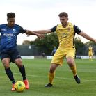 Hornchurch defender Kenzer Lee battles for the ball with Tommy Tejan-Sie of Wingate & Finchley (Pic: