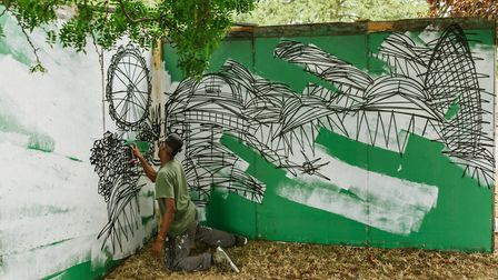 A street artist gets to work at the Makemore festival in Victoria Park. Picture: Mike Massaro