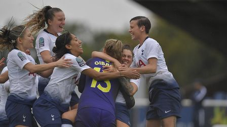 Goalkeeper Emma Gibbon is congratulated after helping Tottenham Hotspur Ladies win their shoot-out w