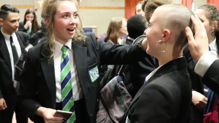 East Point Academy student Hannah Askew, after having her head shaved to raise funds for the Little