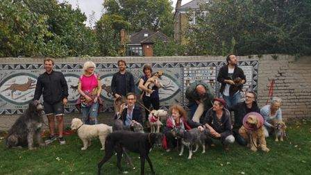 """All of the """"Hounds of Hackney Downs"""" by the mosaic they inspired. Picture: Tessa Hunkin"""