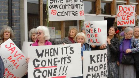 """""""When it's gone, it's gone"""" - placards outside the Highgate Newtown Community Centre last week. Pict"""