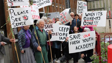 The protesters are concerned about the size of the replacement community centre hall, as well as the