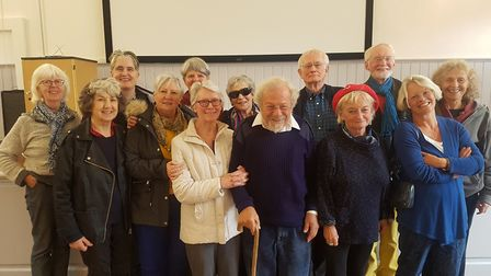 The group of concerned pilates group members in the hall at the community centre