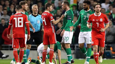 Wales' Ben Davies (centre, left) and Republic of Ireland's Richard Keogh (centre, right) exchange wo