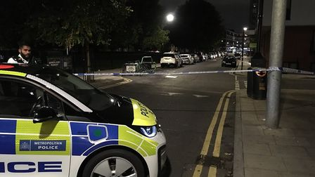 The road was taped off outside Haggerston station after a stabbing. Picture: Joshua J Thurston