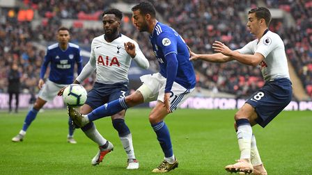 Cardiff City's Victor Camarasa battles for the ball with Tottenham Hotspur's Danny Rose (left) and H