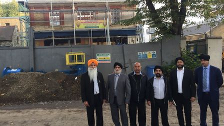 The new committee and members of the community outside the gurdwara.
