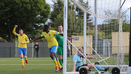 Chinedu McKenzie runs off to celebrate after scoring Haringey Borough's first goal in this season's