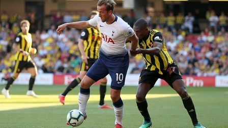 Tottenham Hotspur's Harry Kane (left) and Watford's Christian Kabasele (pic: Nigel French/PA)