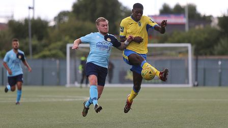 Haringey Borough forward Joel Nouble looks to keep hold of the ball (pic: George Phillipou/TGS Photo