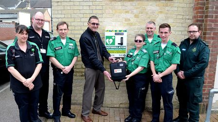 Joe Annis, from Sentinel Lesiure Trust, presenting the defibrillator to Anne Willis, unit clinical l