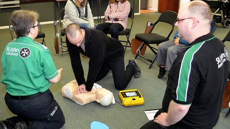 Members of the public being given CPR training at the unveiling of the defibrillator. Picture: Mick