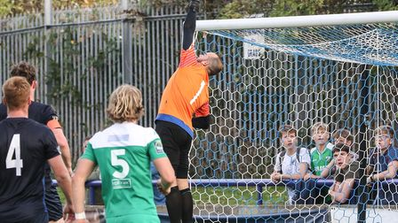 Wingate & Finchley goalkeeper Shane Gore is forced to tip over a Leatherhead effort (pic: Martin Add