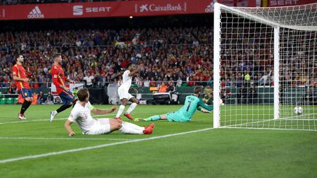 England's Raheem Sterling (back, centre) scores his side's third goal of the game during the UEFA Na