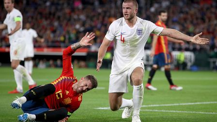 Spain's Sergio Ramos goes down injured as England's Eric Dier protests during the UEFA Nations Leagu