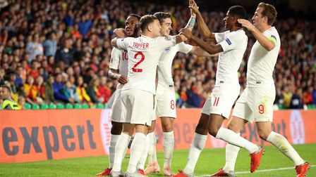 England's Raheem Sterling (far, left) celebrates scoring his side's first goal of the game during th