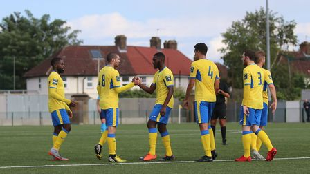 Haringey Borough forward Chinedu McKenzie (centre) is congratulated by his team-mates (pic: George P
