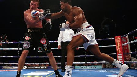 Anthony Joshua (right) hits out against Alexander Povetkin at Wembley Stadium (pic Nick Potts/PA)