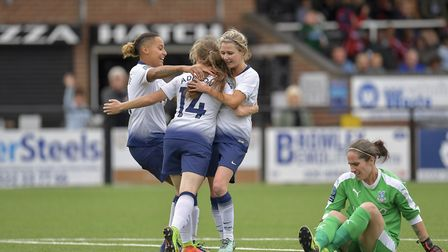 Angela Addison is congratulated by her Tottenham Hotspur Ladies team-mates after scoring at Crystal