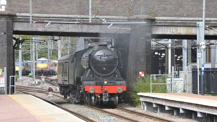 From the old to the new: A Grand Central and LNER train hold back as the Flying Scotsman, built in 1