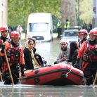 A family being rescued from the floods in Clapton on Wednesday morning. Picture: Paul Wood