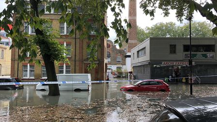 Waterworks Lane is flooded five foot deep and water levels are still rising. Picture: Emma Bartholom