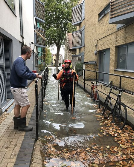 Fire fighters check water levels which are still rising. Picture: Emma Bartholomew